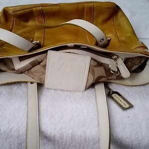 Coach gallery tote patent leather gold purse.